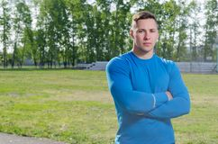 Young athlete with arms crossed at the stadium royalty free stock photos