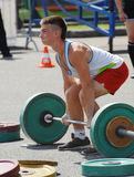 Young athlete raises the barbell Royalty Free Stock Image