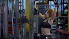 Young athlete raises weight for pumping muscles in the gym. stock footage