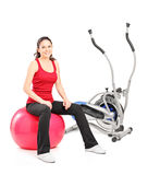 Young athlete resting on a pilates ball Royalty Free Stock Photos