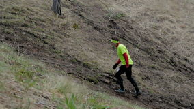 Young athlete runner climbs uphill stock footage
