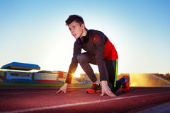 Young athlete runner in a position of readiness to start Stock Photo
