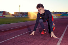 Young athlete runner in a position of readiness to start Stock Images