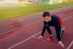 Young athlete runner in a position of readiness to start Royalty Free Stock Photography