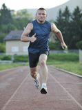 Young athlete running Royalty Free Stock Image