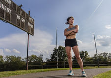Young Athlete Running. An athletic female exercising on a track outdoors Stock Image