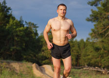 Young athlete running outdoors Royalty Free Stock Photos