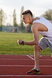 Young athlete running at the running track Royalty Free Stock Photos