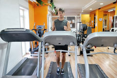 Young athlete running on tapis roulant in the gym - fitness wellness healthy lifestyle concept Stock Photography