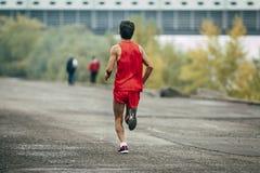 Young athlete runs a marathon Royalty Free Stock Image
