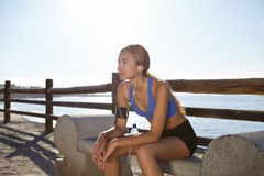 Young athlete sitting outside in summertime Stock Images