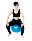 Young athlete sitting on a swiss ball Royalty Free Stock Photos