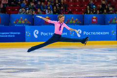 Young athlete skater male performance in short program on ice Stock Photos