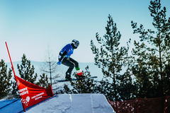 Young athlete snowboarder jumping springboard Royalty Free Stock Photos