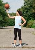 Young Athlete Spinning Basketball Stock Images