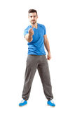 Young athlete in sportswear showing middle finger angry gesture Stock Images