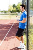 Young athlete taking a break on a hot summer day Royalty Free Stock Image