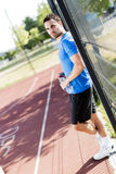 Young athlete taking a break on a hot summer day Stock Images