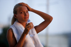 Young athlete taking a rest royalty free stock images