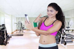 Young athlete taking selfie photo at gym Royalty Free Stock Images
