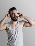 Young athlete in tank top enjoying music Royalty Free Stock Photography