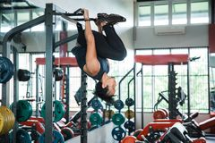 Young athlete turn upside down working out indoor Stock Photography