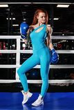 Young athlete woman in boxing gloves standing on ring Stock Images