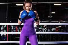Young athlete woman in boxing gloves standing on ring Royalty Free Stock Photography