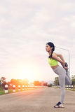 Young athlete woman exercises outdoor in park,  relax in nature. Young athlete girl exercises workout outdoor in park. calmness and relax concept, woman Royalty Free Stock Image