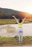 Young athlete woman exercises outdoor in park,  relax in nature Royalty Free Stock Photos