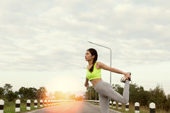 Young athlete woman exercises outdoor in park,  relax in nature. Young athlete girl exercises workout outdoor in park. calmness and relax concept, woman Stock Photography