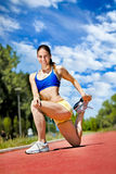Young athlete woman exercising Royalty Free Stock Photos
