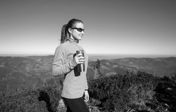 Young athlete woman hiker enjoying her rest royalty free stock photography
