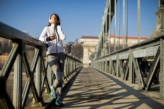 Young athlete woman with mobile phone outdoor stock images