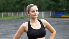 Young Athlete Woman in Sport Outfit Engaged in Fitness on the Sports Field in the Park. stock video