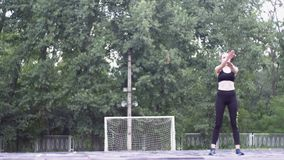 Young Athlete Woman in Sport Outfit Engaged in Fitness on the Sports Field in the Park. stock video footage