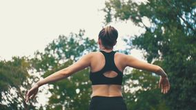 Young Athlete Woman in Sport Outfit Engaged in Fitness on the Sports Field in the Park. stock footage
