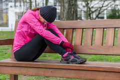 Young athlete woman tired or depressed resting on a bench Stock Photos