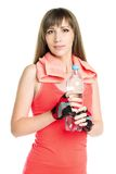 Young athlete woman with towel holding bottle with water Stock Images