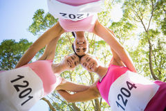Young athlete women forming huddles Royalty Free Stock Photos