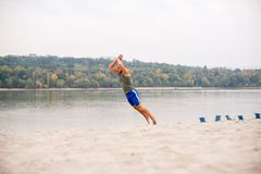 Work out on sand. Young athlete work out on sand Stock Photo
