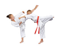 Young athletes beat karate blows Royalty Free Stock Photography