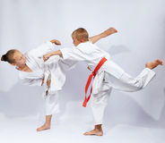 Young athletes beats karate blows Stock Image