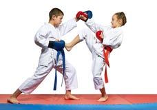 Young athletes beats kick leg and hand Royalty Free Stock Photo