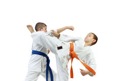 Young athletes are doing paired exercises karate Royalty Free Stock Photography