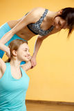 Young athletes doing stretching exercises. In gym Royalty Free Stock Photography