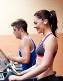 Young athletes exercising on a running machine Stock Photos