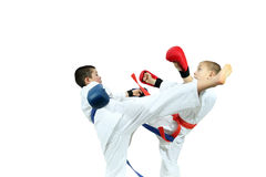 Young athletes with overlays on hands are training blows legs Stock Image