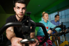 Young athletes practiced on simulators Stock Photo