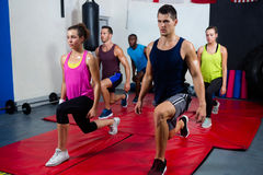 Young athletes practicing lunge exercise royalty free stock photo
